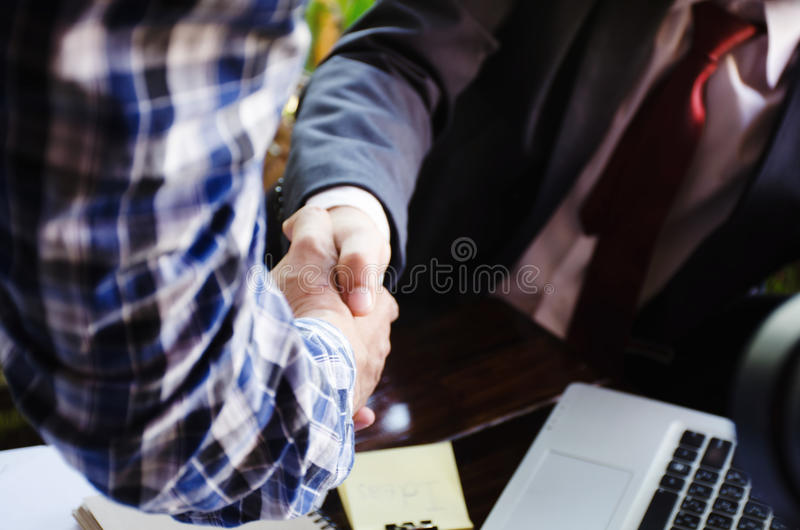 Business man handshake. Successful businessmen handshaking after good deal. Business version in fact of corporation, good deal, successful stock photography