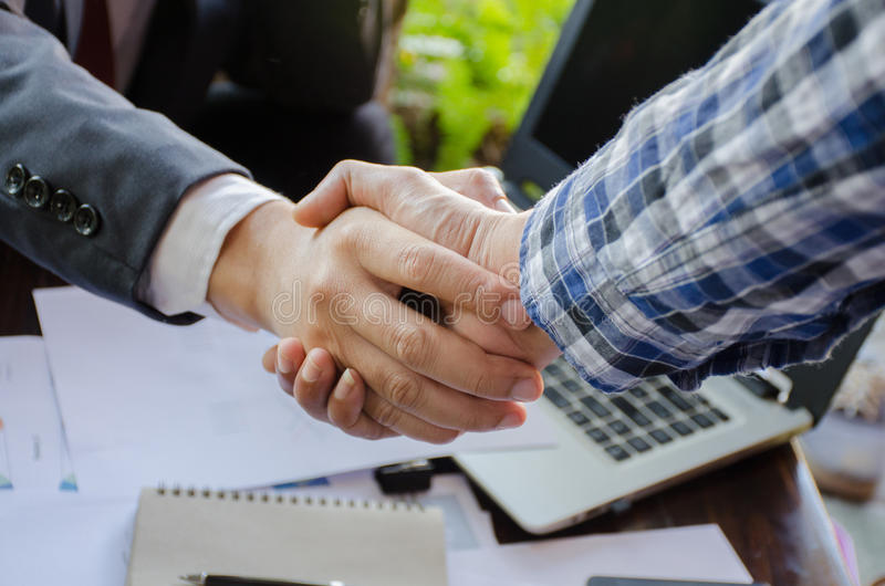 Business man handshake. Successful businessmen handshaking after good deal. Business version in fact of corporation, good deal, successful royalty free stock photos