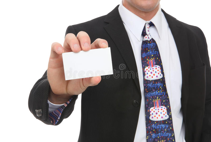 Business Man with Happy Birthday Tie. A business man with a happy birthday tie handing card royalty free stock photos