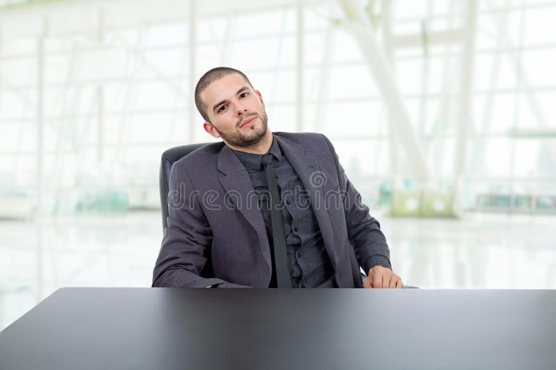 Business man. Happy business man on a desk, at the office royalty free stock images