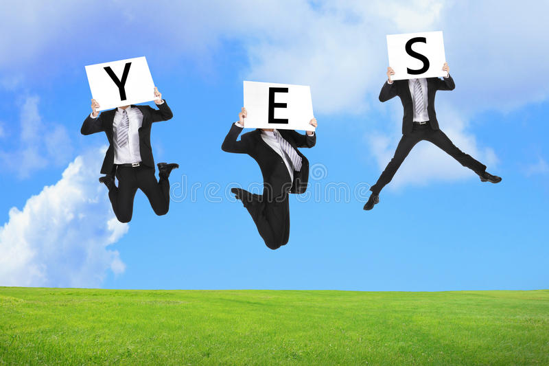 Business man happy jumping with yes text royalty free stock photos