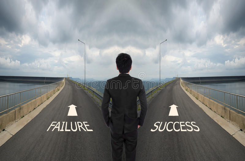 business man has to decide between two different way, choose Failure or Success road stock photo