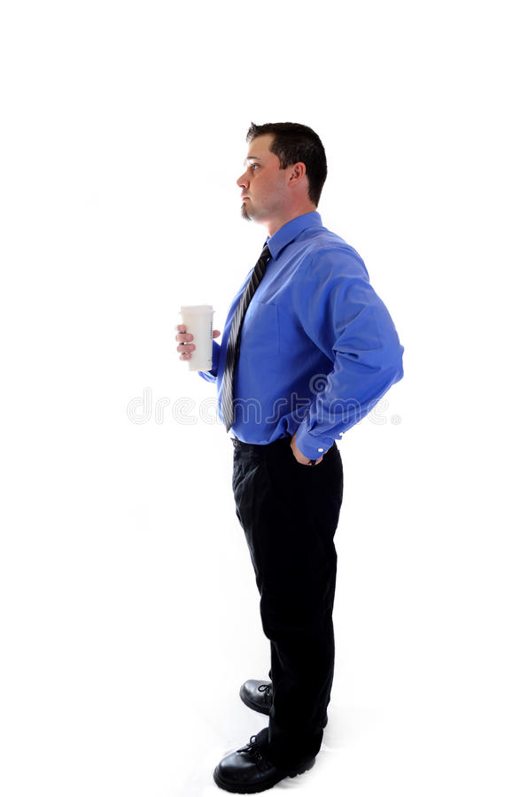 Business man having coffee. A business man in blue shirt and tie holding a cafe coffee cup royalty free stock photo