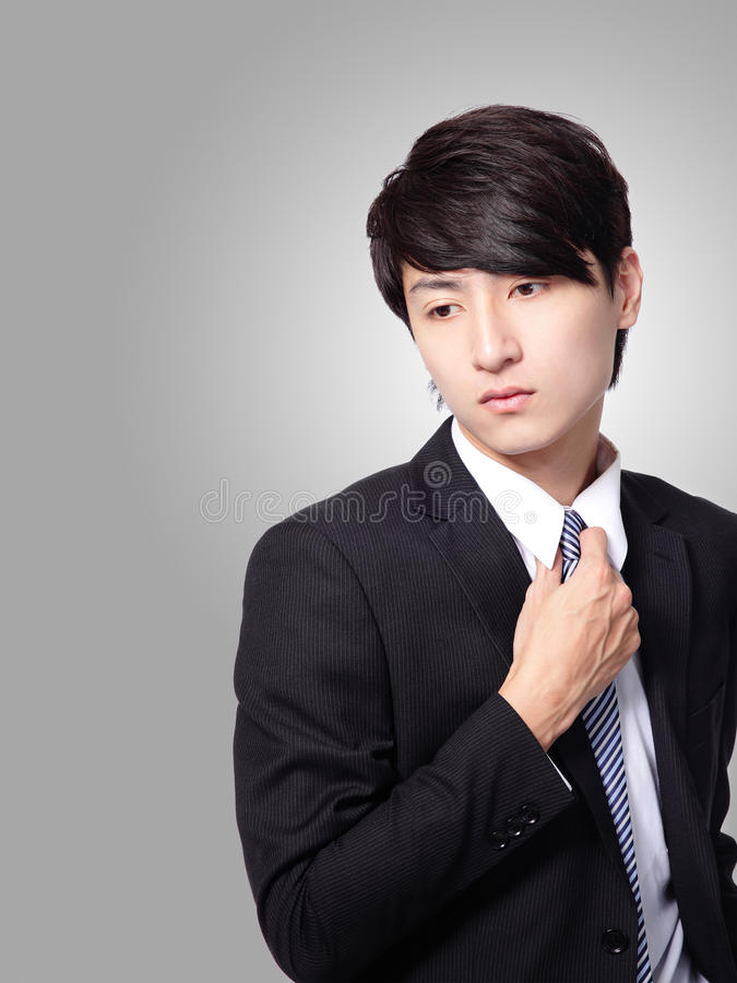 Business man having stress and touch his tie royalty free stock photography