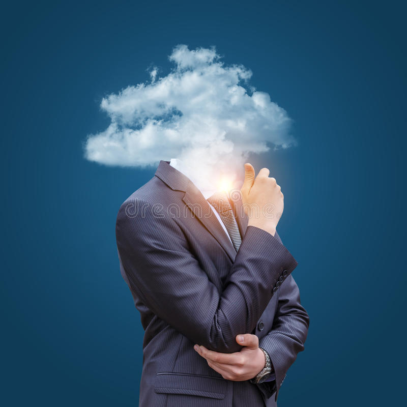Business man with head in the clouds. royalty free stock photography