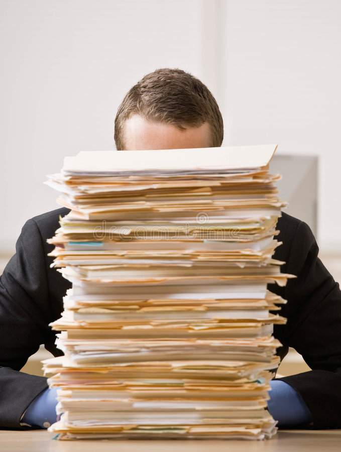 Download Business Man Hiding Behind Tall Stack Of Folders Stock Photo - Image: 6604944