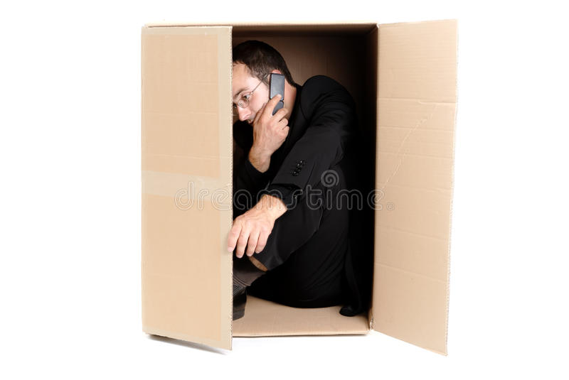 Download Business Man Hiding In A Carton Box Stock Image - Image: 10242703
