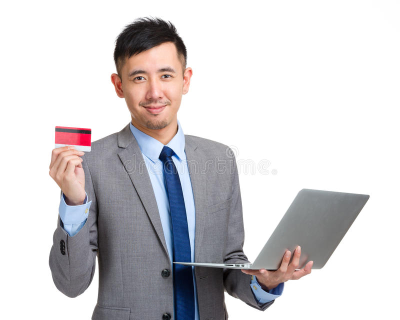 Business man hold credit card and laptop stock photography