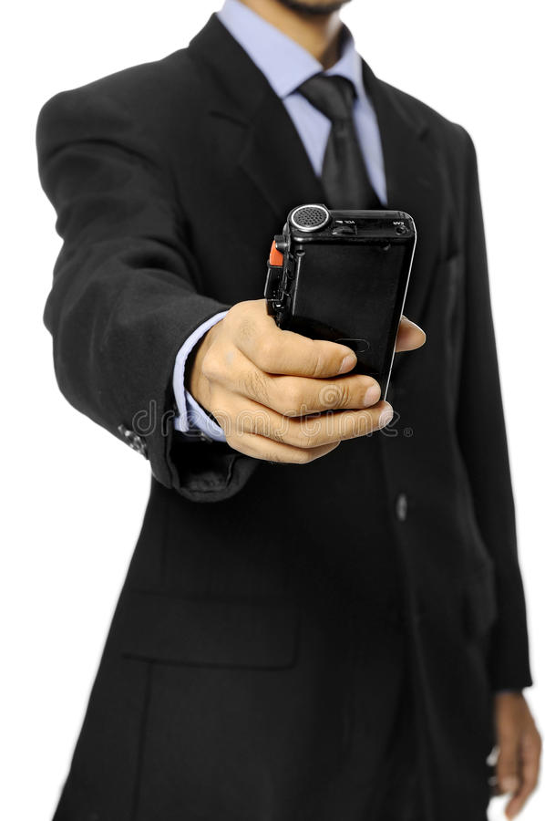 Business Man Hold Dictaphone. Businessman speaking into a dictaphone recorder isolated over white background stock images