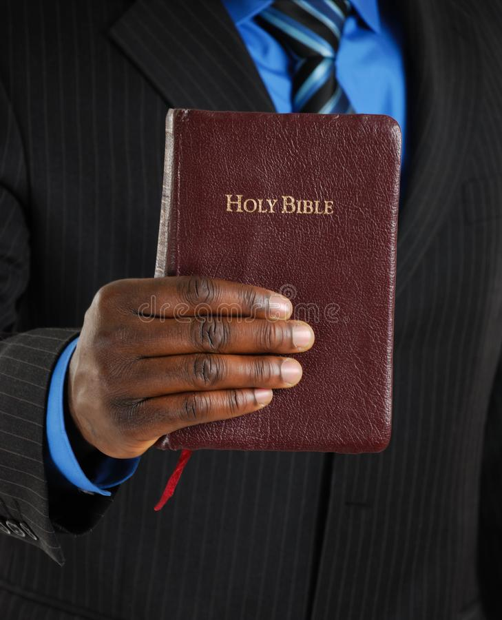 Business man holding a bible royalty free stock images