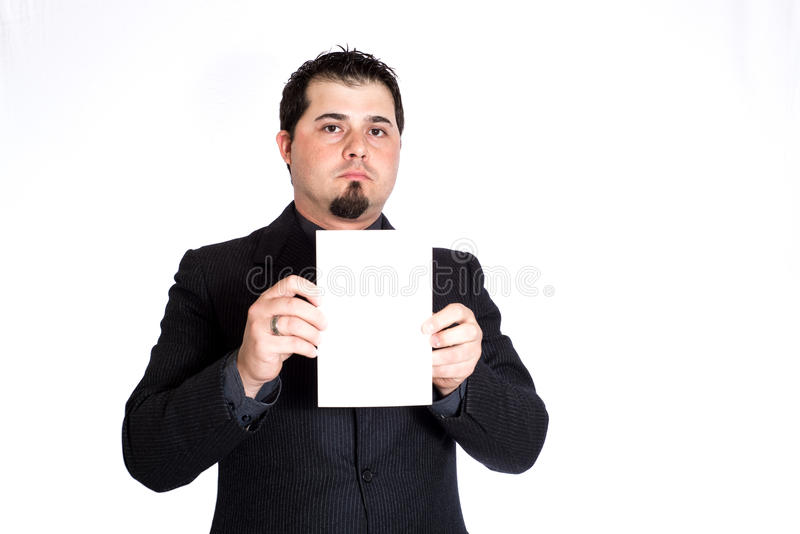 Business man holding blank card. A businessman holding blank 5x9 card. White background. Product placement royalty free stock photo