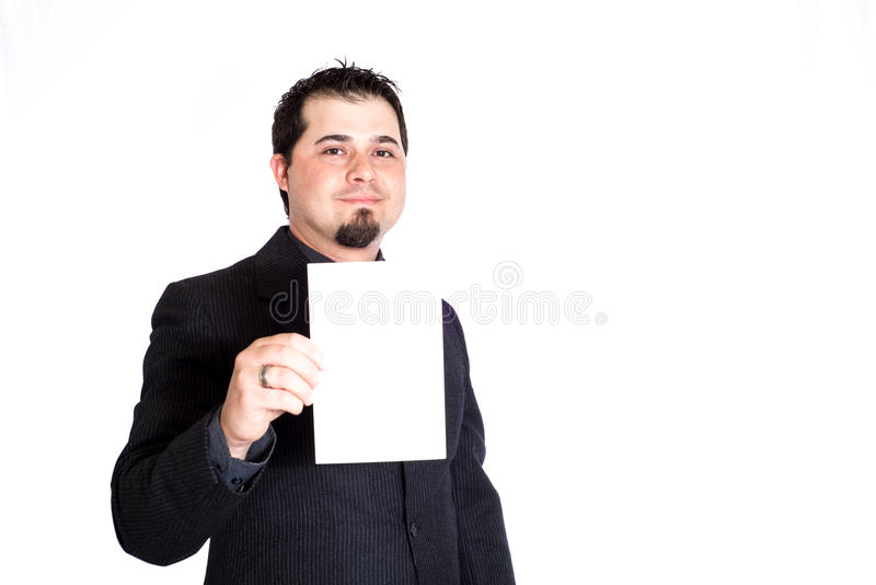 Business man holding blank card. A businessman holding blank 5x9 card. White background. Product placement stock image