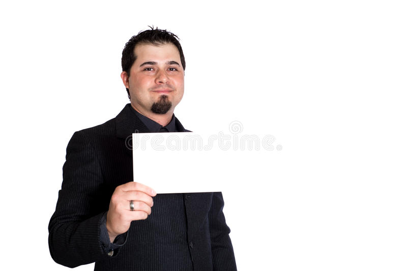 Business man holding blank card. A businessman holding blank 5x9 card. White background. Product placement royalty free stock photography