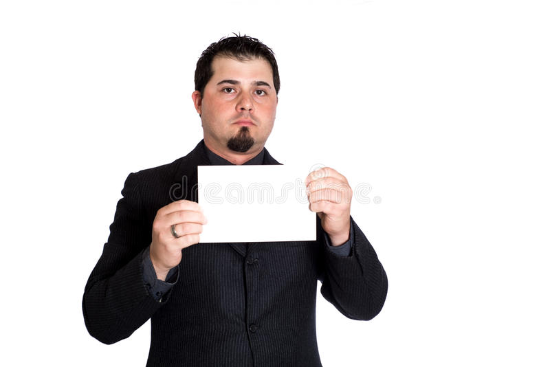 Business man holding blank card. A businessman holding blank 5x9 card. White background. Product placement stock images