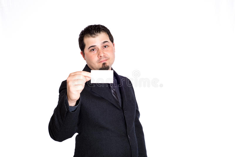 Business man holding blank card. A businessman holding blank business card. White background. Product placement royalty free stock photos