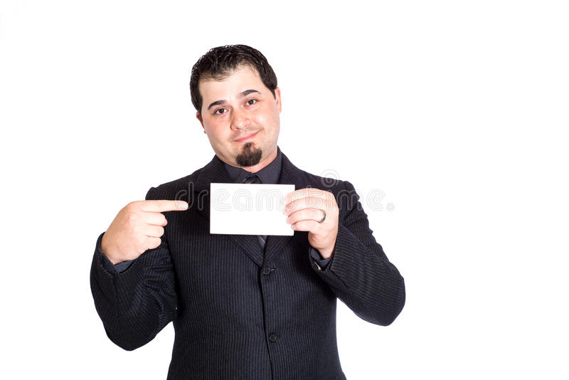 Business man holding blank card. A businessman holding blank card. White background. Product placement royalty free stock photo