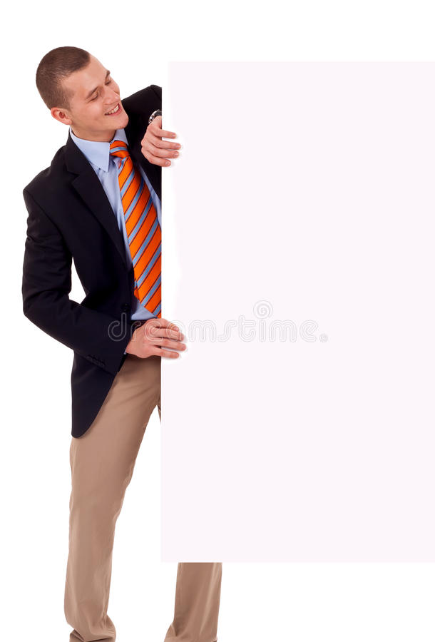Business man holding blank poster stock image