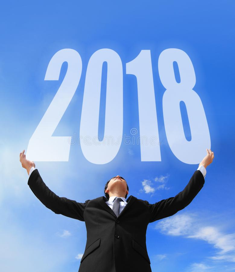 Business man holding 2018 stock images