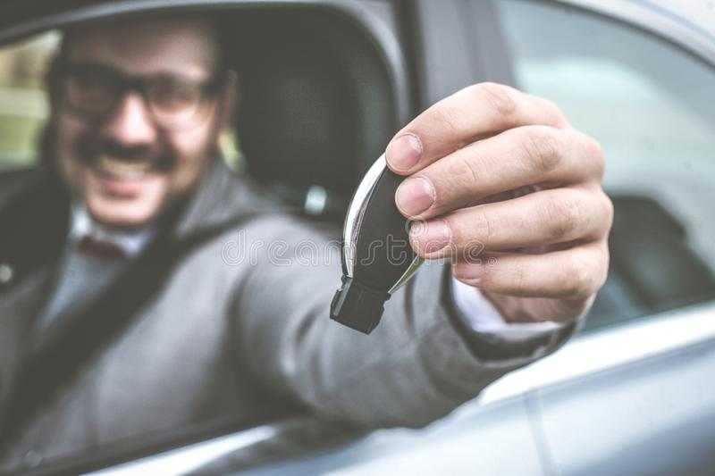 Business man holding car key. royalty free stock images
