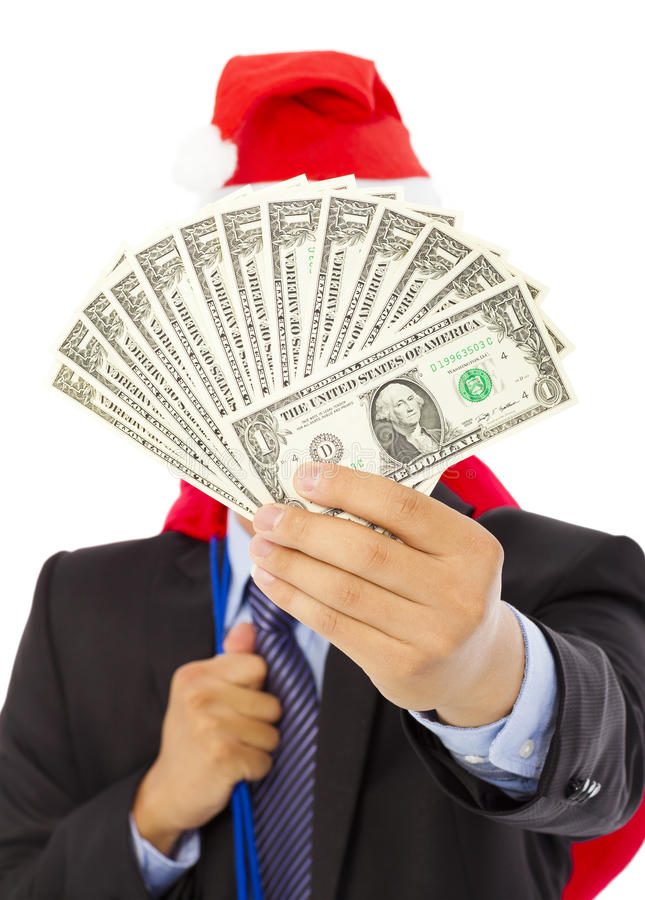 Business man holding a christmas gift bag and money. Over white background royalty free stock images