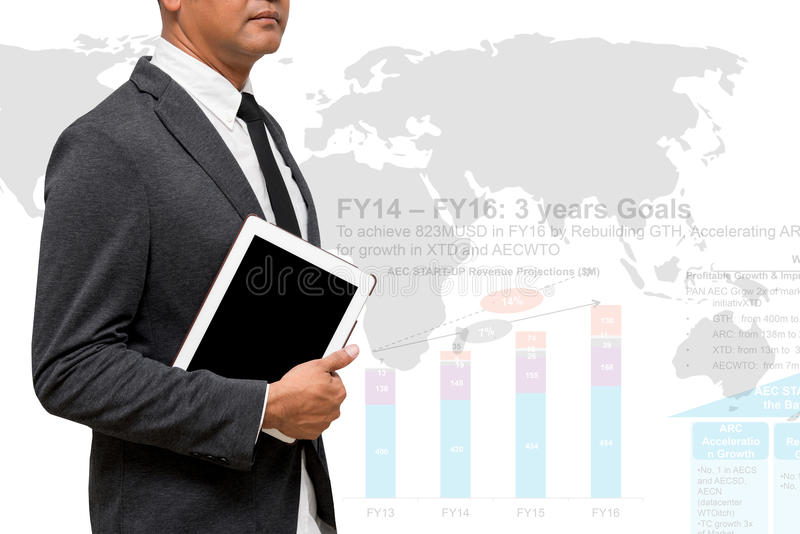 Business man holding computer tablet with world map and business. Charts stock images