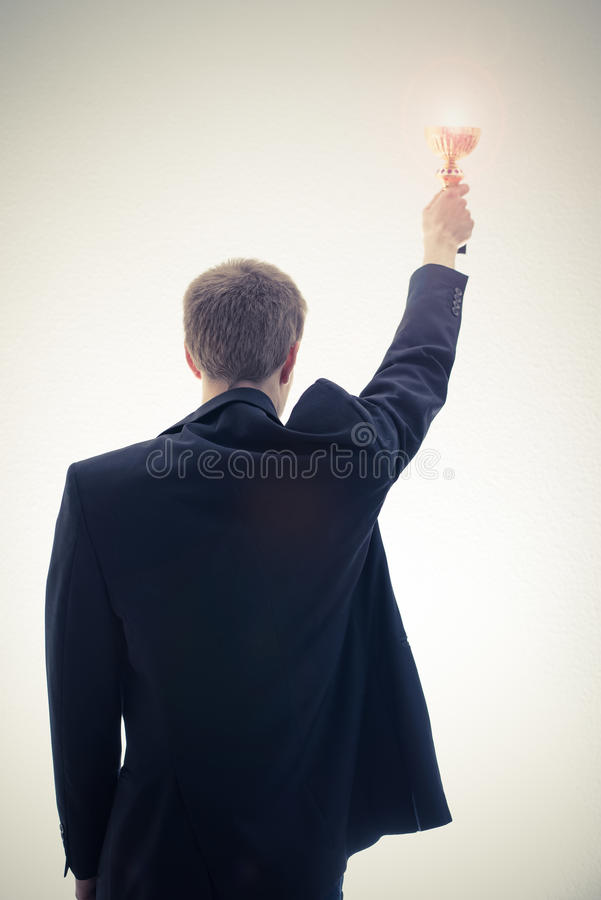 Business man holding cup royalty free stock image