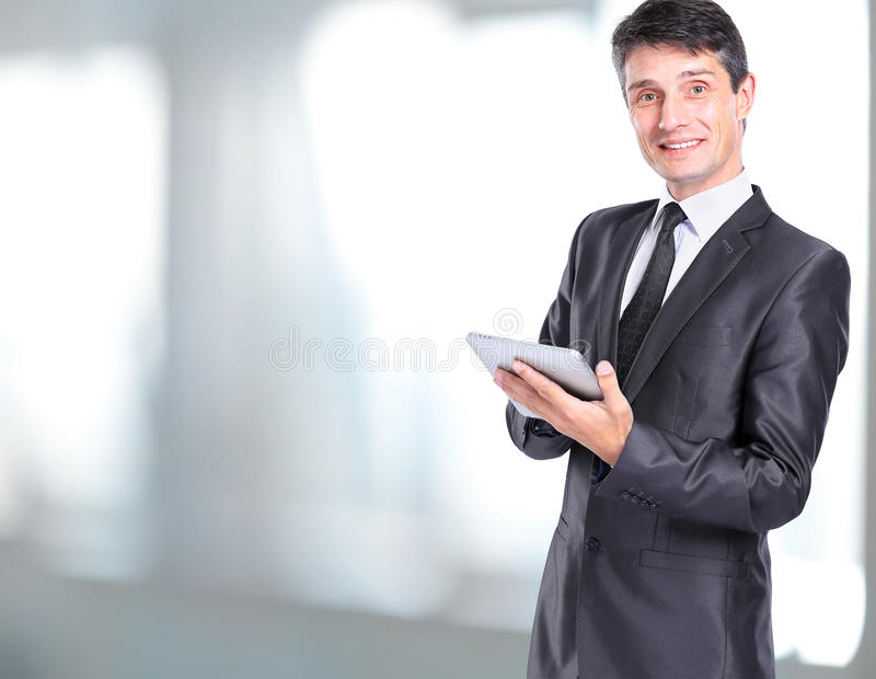 Business man holding a digital tablet stock images