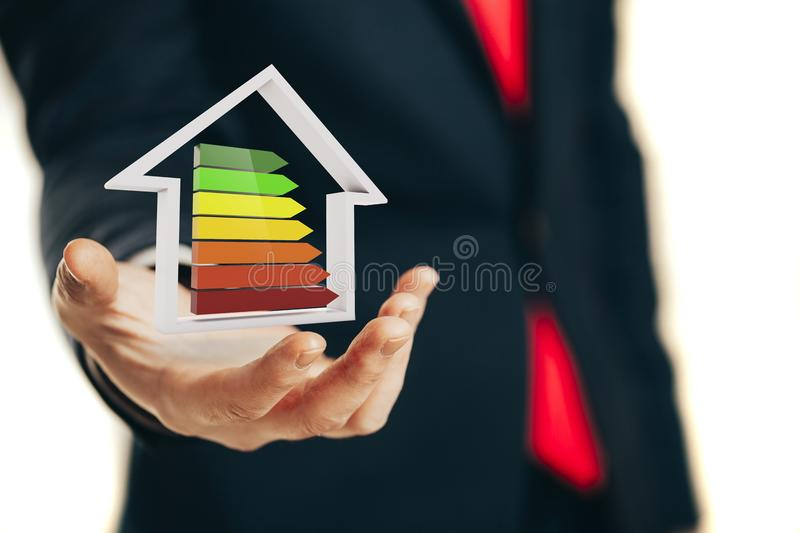 Business man holding an efficiency performance scale stock photo