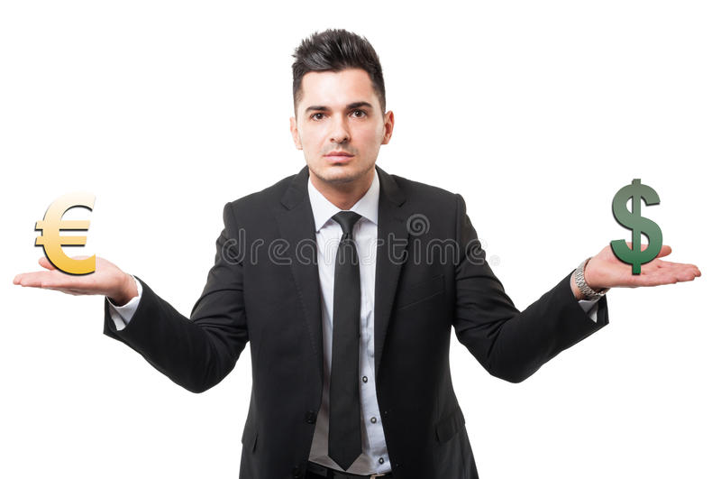 Business man holding euro and dollar symbols or signs. Euro versus dollar concept isolated on white background royalty free stock images