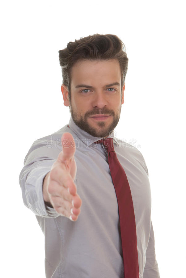 Business man holding hand out for handshake stock photography