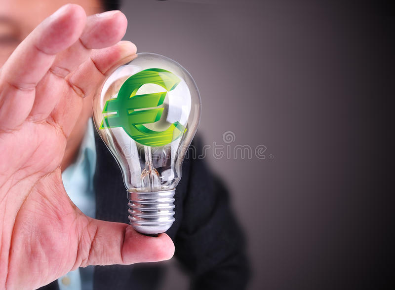 Business man holding idea of euro finance stock photography