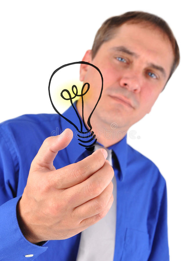 Business Man Holding Idea Light Bulb. A business man is holding a drawing of an idea light bulb on a white background. Use it for an innovation concept royalty free stock image
