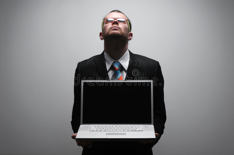 Business man holding laptop. Looking up royalty free stock photo