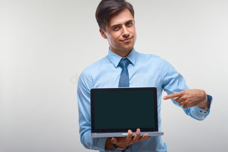 Business man holding a laptop against a white background.  royalty free stock images