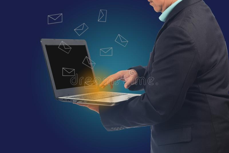 Business man holding a laptop to check email ,. Business concept stock photography
