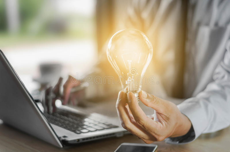 Business man holding light bulb, concept idea with innovation an. D creativity stock image