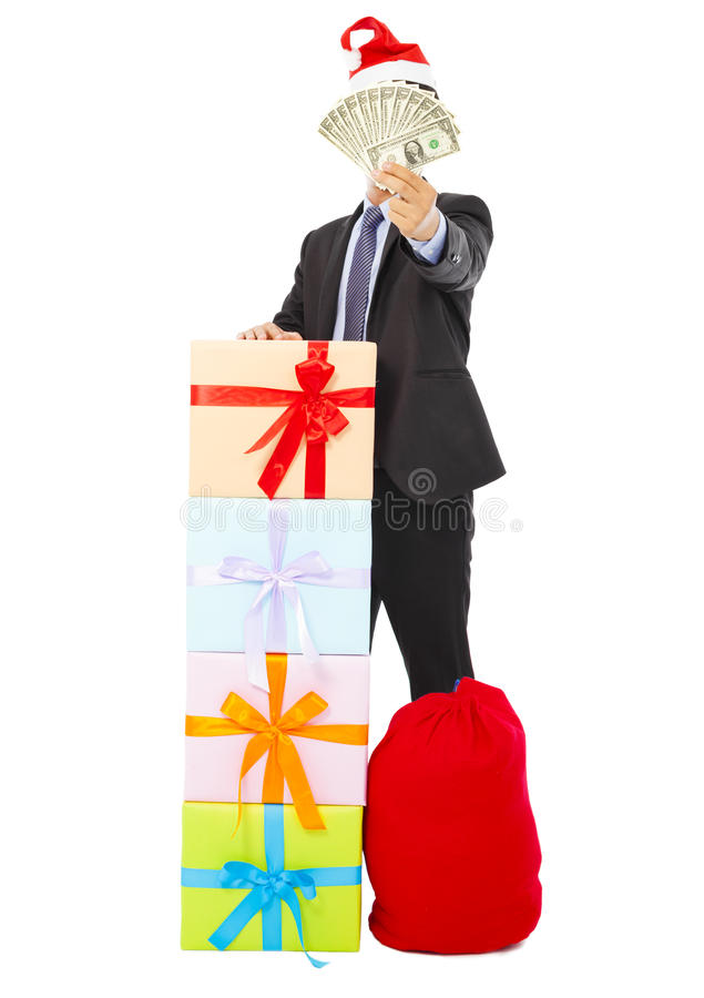 Business man holding money with gift box and bag. Over white background stock photo