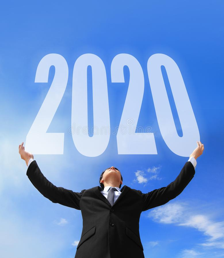 Business man holding 2020 royalty free stock photography