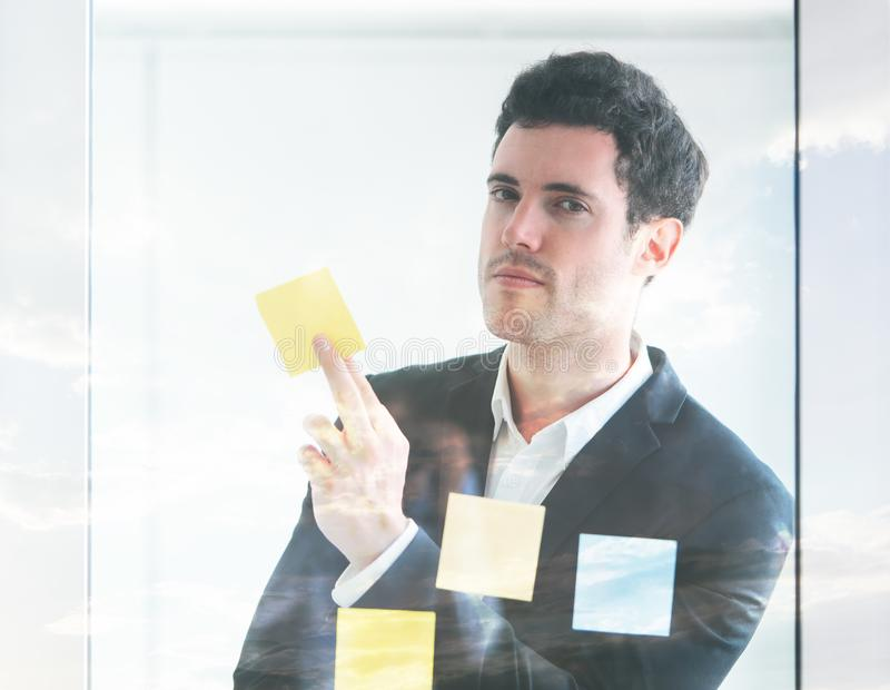 Business man holding note for idea concept. Business man holding note paper for idea concept royalty free stock photo