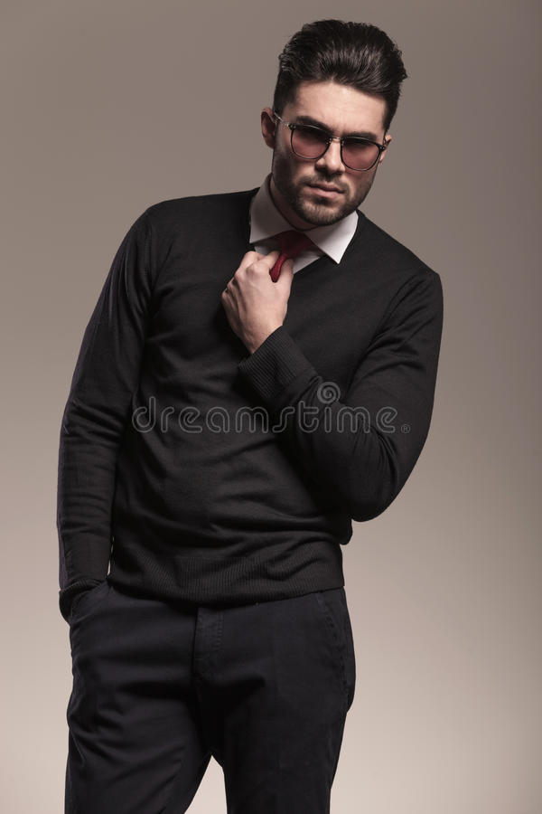 Business man holding one hand in his pocket stock images
