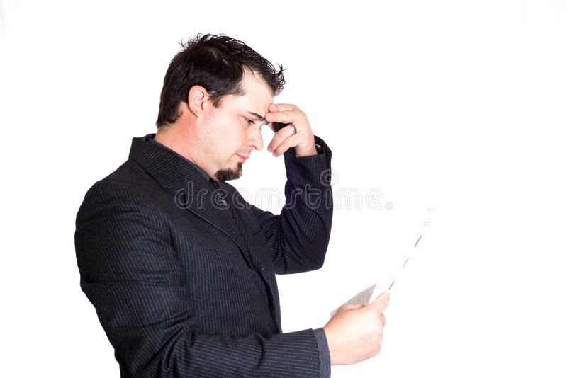 Business man holding paperwork. A businessman holding paperwork, looking stressed. White background. Product placement stock images