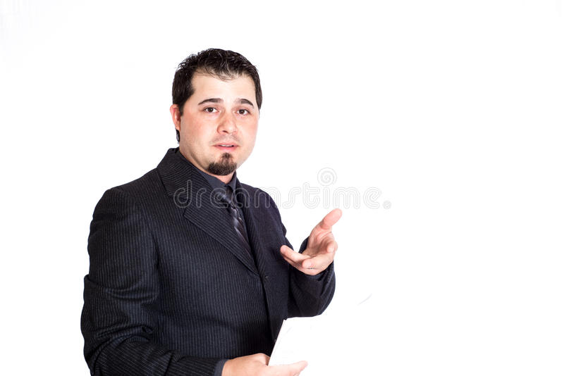 Business man holding paperwork. A businessman holding paperwork, talking. White background. Product placement stock photo