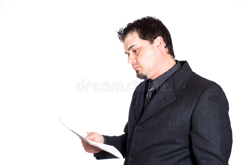 Business man holding paperwork. A businessman holding paperwork. White background. Product placement stock photography