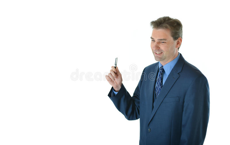 Download Business Man Holding A Pen Stock Photo - Image: 83718952