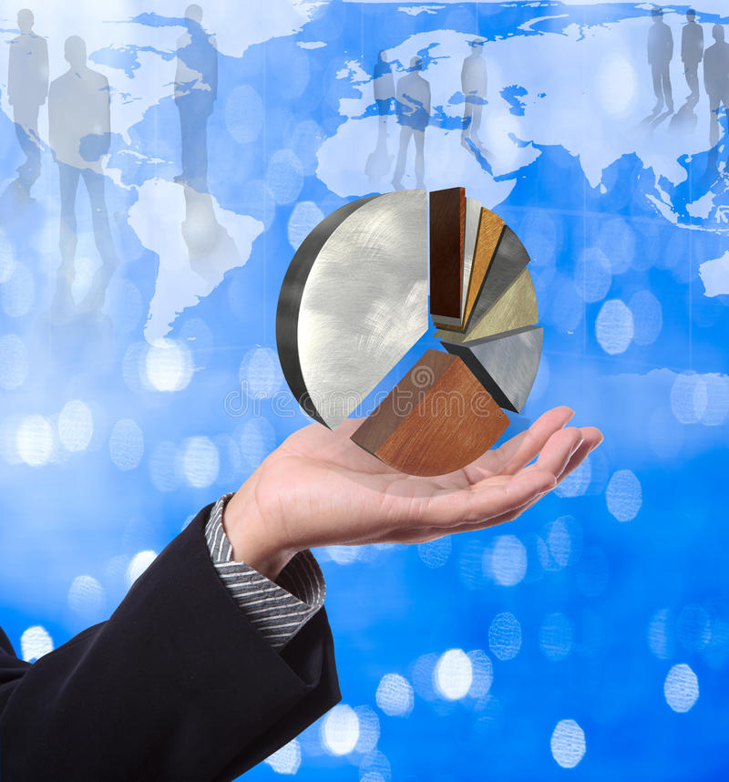 Business man holding pie graph stock photo