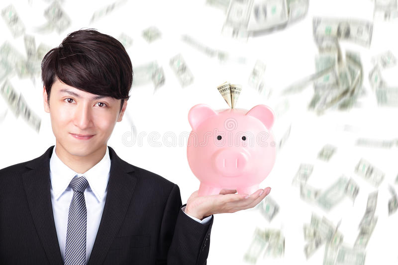 Download Business Man Holding Pink Piggy Bank Stock Photo - Image: 33960152