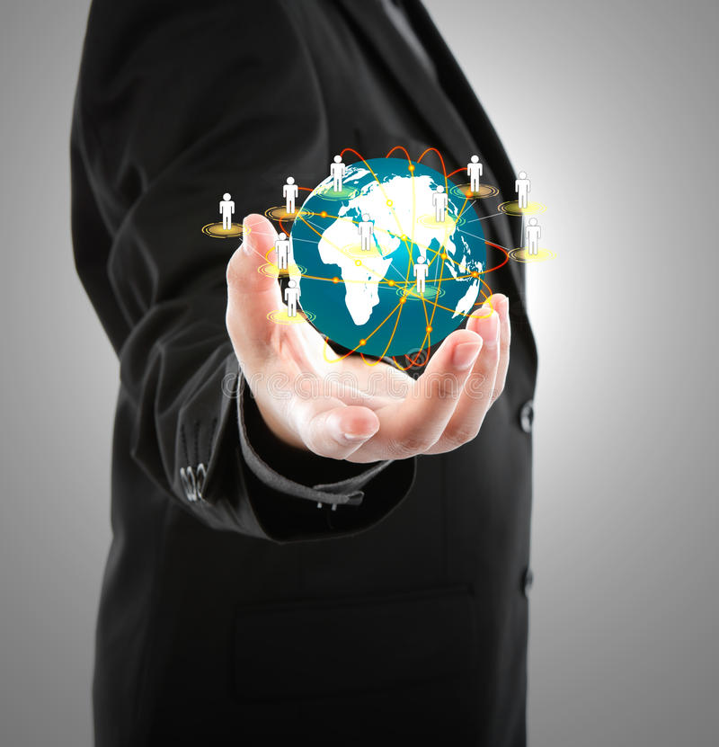 Business man holding the small world. In his hands royalty free stock images