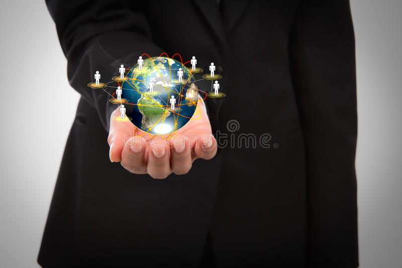 Business man holding the small world in his hands. Against white background (Elements of this image furnished by NASA royalty free stock photography