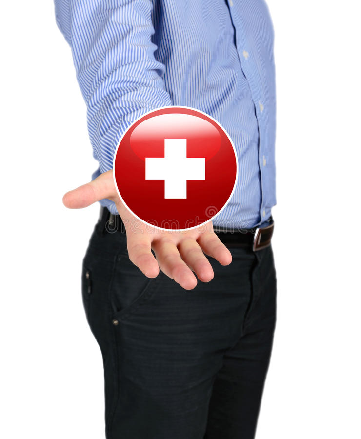 Business Man Holding A Symbol Of The Red Cross Stock Photo Image