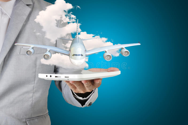 Business man holding tablet present airplane in his hand royalty free stock images